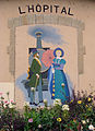 Peinture murale de Peter Musslé, gare de L'Hôpital.jpg