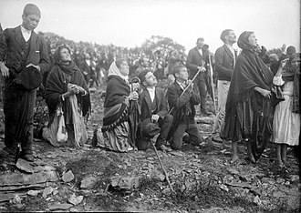 Fátima, Portugal - A close-up of the Christian pilgrims during the Miracle of the Sun on 13 October 1917.