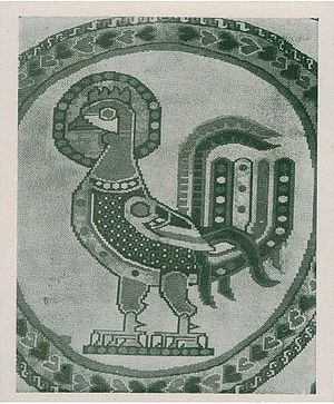Sacred - Vatican Persian Cock – A 1919 print of a fabric square of a Persian cock or a Persian bird design belonging to the Vatican (Holy See) in Rome dating to 600 CE. Notice the halo denoting the status of being holy or sacred.