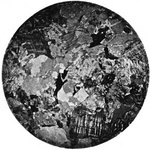 Woodstock Quartz Monzonite - Photomicrograph of the Woodstock Quartz Monzonite. Field is about 0.85 cm, under crossed polarized light (1898)