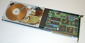 Plus Development - A Hardcard 20 hard disk on a card with an acrylic cover for display purposes. The Hardcard from Plus Development was the first hard drive on a plug in card for PCs.