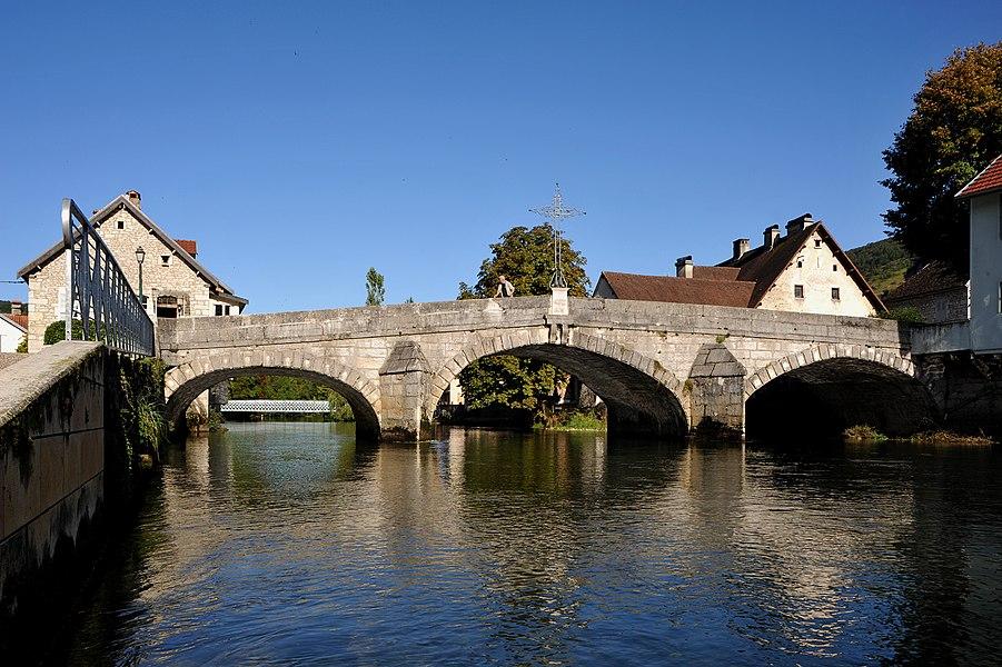 Old bridge over the Loue in Vuillafans; Franche-Comté, France.