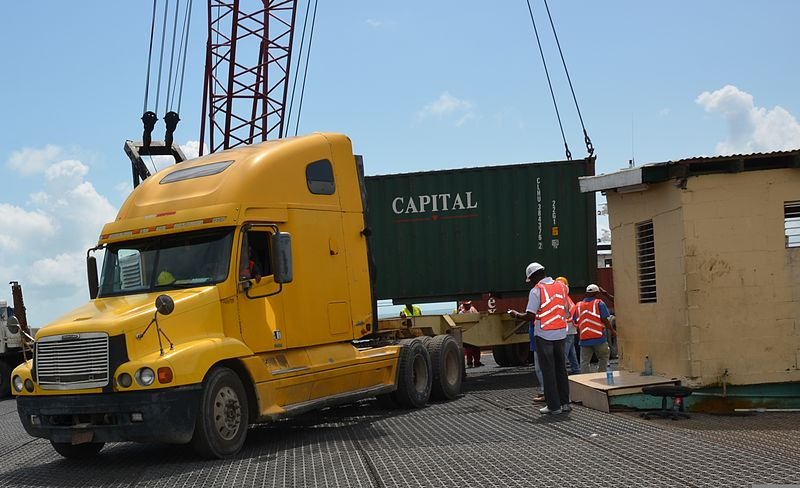 File:Port of Belize transportation managers move equipment for New Horizons 2014 from the barge onto the pier in Belize City, Belize, March 8, 2014 140308-F-HI762-028.jpg