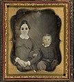 Portrait of blind woman (wearing dark glasses) and child (4420682988).jpg
