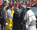 Pranab Mukherjee and the Chief Guest of Republic Day the King of Bhutan, His Majesty Jigme Khesar Namgyel Wangchuck being received by the Prime Minister, Dr. Manmohan Singh and the Defence Minister, Shri A. K. Antony.jpg