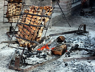 The Amazing Race 27 - For the Roadblock in the Pampas region, team members had to properly hang racks of lamb and beef to make asado, an Argentine national dish.