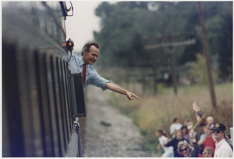 President Bush waves from the back of the train outside of Bowling Green as he travels on a whistlestop campaign... - NARA - 186459