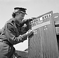 Private Margaret Hicks of the Auxiliary Territorial Service (ATS), serving with a mixed anti-aircraft battery on the South Coast, paints another V-1 flying bomb 'kill' on the battery scoreboard, 6 August 1944. H39811.jpg