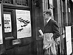 Prospective RAF recruit Michael Suthers arrives at Euston Combined Recruits Centre and is attracted by a poster on the door showing a formation of Hawker Hurricane fighters in flight, November 1940. CH1645.jpg