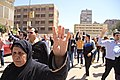 Protesters march through Cairo holding up four-fingers as R4bia sign in memory of 2013 deadly crackdown on supporters of ousted President Morsi - 28-Mar-2014.jpg