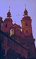 Pyramide 3 men on bikes on Church saint Havel in Prague.jpg