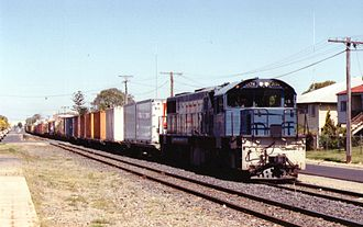 Rail transport in Queensland - 2174 hauls a northbound goods train on the Denison Street section of the North Coast Line in Rockhampton