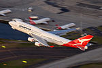 Qantas Boeing 747-400 (VH-OEG) climbs after take off at Sydney Airport.jpg