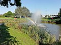 Rainbow in the fountain Lake at Cheadle Royal Business Park.jpg