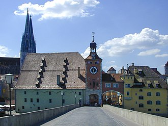 Stone Bridge (Regensburg) - The remaining tower at the south end of the bridge, with tramway arch to the right, and Salt Store; Regensburg Cathedral in the background.