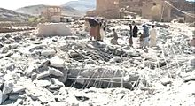 Residents of Hidrhan examine a bomb site a pile of rubble that only two days before was their village mosque.jpg