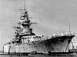 Richelieu-class battleship - Richelieu at Dakar, in 1941; there were three fire control systems atop the fore tower and neutrality tricolor bands on turret II