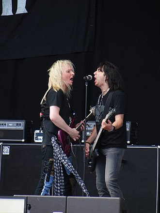 Bruno Ravel - Robert Marcello (left) and Bruno Ravel (right) performing at the 2014 Sweden Rock Festival.