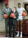 Ronald Reagan with John Thompson, Patrick Ewing (cropped).jpg