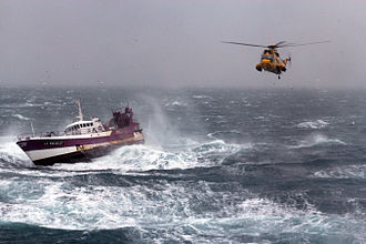Fisherman - A Royal Air Force search and rescue Sea King helicopter comes to the aid of the French fishing vessel Alf during a storm in the Irish Sea.