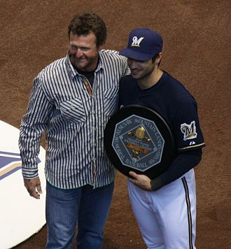 Ryan Braun - Braun accepts his 2011 National League MVP award from 1989 American League winner Robin Yount.