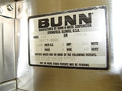Close-up of the Bunn label on a coffee grinder.