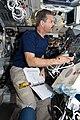 STS-125 Commander Altman Working on the Flight Deck (28075653172).jpg