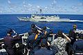 Sailors salute HMAS Sydney. (9137311496).jpg