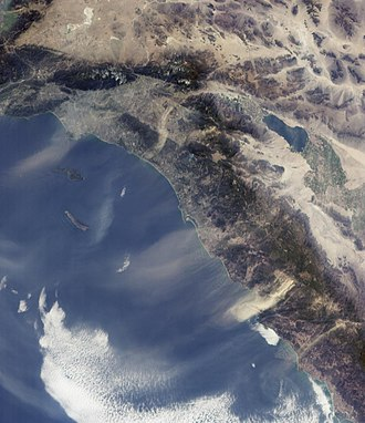 Santa Ana winds - The Santa Ana winds sweep down from the deserts and across coastal Southern California, pushing dust and smoke from wildfires far out over the Pacific Ocean. Los Angeles is in the upper left of this image, while San Diego is near the center.
