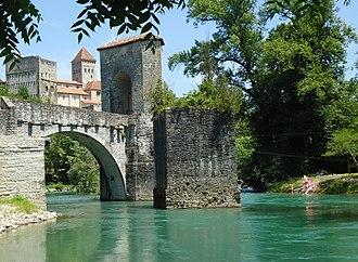 Sauveterre-de-Béarn - View up to Medieval village of Sauveterre de Bearn with the Pont de la Legende (foreground)