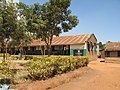 School buildings (classroom), this one has a rainwater harvesting tank. The school UDDT is visible just behind this building. (6876119963).jpg
