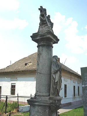 Obrovac, Serbia - Image: Sculpture in front of the Saint Ferdinand the Bishop Catholic Church, Obrovac, Vojvodina, Serbia 20060602