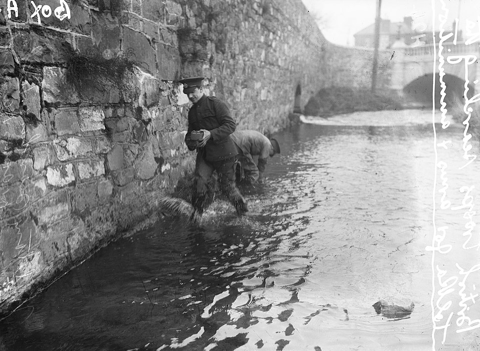Searching the River Tolka in Dublin for arms
