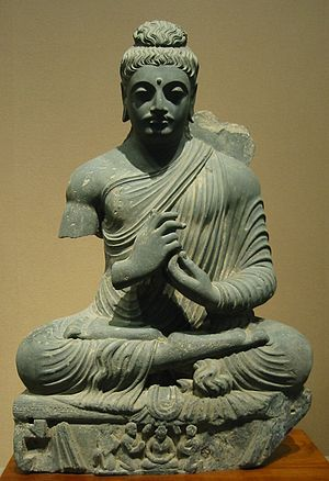 Physical characteristics of the Buddha - Seated Buddha, Gandhara, 1st-2nd century CE. Tokyo National Museum