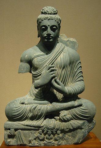 Physical characteristics of the Buddha - Seated Buddha, Gandhara, 1st-2nd century CE. Tokyo National Museum