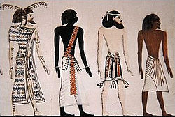 Four peoples of the world:a Libyan, a Nubian, an Asiatic (wearing fringes), and an Egyptian. An artistic rendering, based on a mural from the tomb of Seti I.