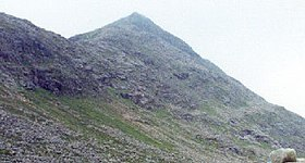 Colour photograph of the Scottish mountain Sgòr an Lochain Uaine from the entrance to An Garbh Coire