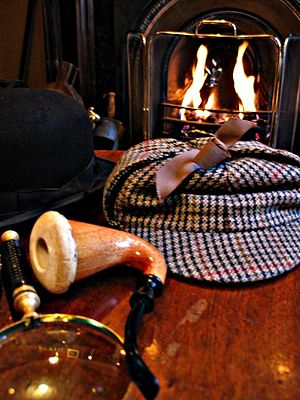 Deerstalker - A deerstalker (right) along with a calabash pipe and a magnifying glass, paraphernalia typically associated with Sherlock Holmes