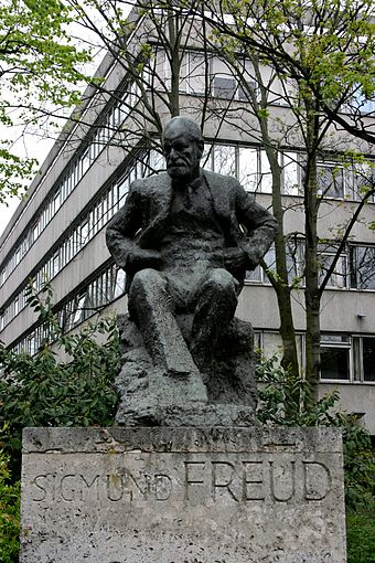 The Sigmund Freud memorial in Hampstead, North London, by Oscar Nemon. The statue is located near to where Sigmund and Anna Freud lived, now the Freud Museum. The building behind the statue is the Tavistock Clinic, a major psychological health care institution. Sigmund Freud statue, London 1.jpg