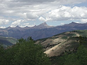 Uncompahgre Peak - Uncompahgre Peak (center) and the San Juans from Slumgullion Pass, July 2002