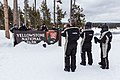 Snowmobiler group photo at the South Entrance sign (40db392c-5842-4397-a1ee-370e8417f6d0).jpg
