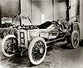 Special built Briscoe racing car the ran in the 1908 Indianapolis race in a show room.jpg