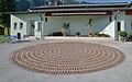 Spiral pavement in front of Gemeindesaal Weng im Gesäuse.jpg