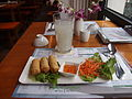 Spring rolls and lychee juice at restaurant Nam Nam in Munich.jpg