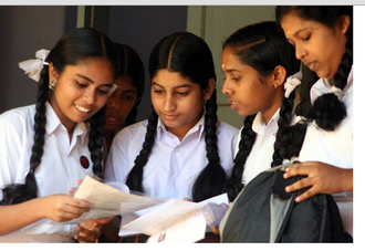 Secondary School Leaving Certificate - SSLC students evaluating question paper after examination.