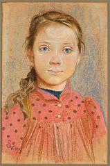 A girl in a red polka-dot dress