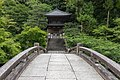 Stone bridge leading to a cemetery surrounded by trees in the compounds of Chion-in Kyoto Japan.jpg