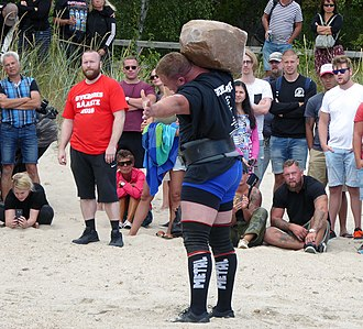 """Strength athletics - """"Natural stone to shoulder"""". The stone weighs 165 kg"""