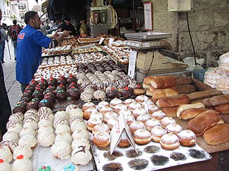 Sufganiyah - Powdered and iced sufganiyot for sale in Jerusalem before Hanukkah 2014