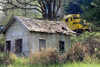 Summit, Oregon - A train passing by Summit's former post office